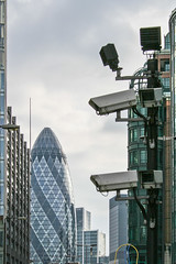 Gherkin and CCTV (Gary Kinsman) Tags: bishopsgate london ec2 cityoflondon canonrebelxt canon350d canon1855mm zoom telephoto compression tower highrise skyline skyscraper gherkin 30stmaryaxe willisbuilding cctv sthelens architecture overcast clouds