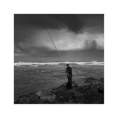 Bracing the Storm (^soulfly) Tags: streetphotography morocco casablanca fisherman bw