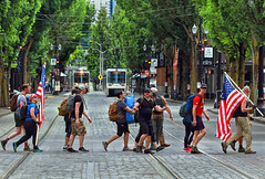 Crossing The Lines (Ian Sane) Tags: ian sane images crossingthelines marching gorucklightchallenge trains tracks trimet max first avenue american flags old town portland oregon june302018 candid street photography canon eos 5ds r camera ef100400mm f4556l is usm lens zoom