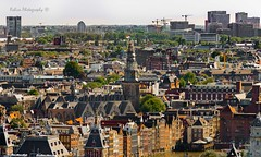 Amsterdam - De Oude Kerk - Looking down on tall buildings (Robica Photography) Tags: robicaphotography cityphotography streetphotography 2018 d3200 amsterdam building water skyline architecture city people sunny deoudekerk old monument church towers dutch houses crane cityscape