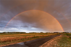 Bow over lots of Rain! (karindebruin) Tags: colors hellevoetsluis thenetherlands voorneputten zuidholland clouds polder rainbow regenboog sunset wolken