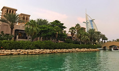 Madinat Jumeirah (2) (Irina.yaNeya) Tags: madinatjumeirah uae emirates dubai city urban architecture building water sea ocean reflection waves trees palms hotel sky bridge sunset iphone resort eau dubái cielo ciudad arquitectura edificio agua mar reflejo árboles puente مدينة الامارات دبي‎‎ فنمعماري بناء ماء بحر أشجار سماء غروب جسر дубаи оаэ эмираты город архитектура вода море отражение деревья пальмы небо курорт мост закат