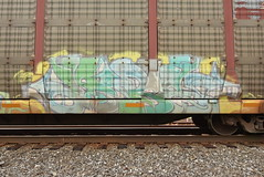? (TheGraffitiHunters) Tags: graffiti graff spray paint street art colorful benching benched freight train tracks racks autoracks