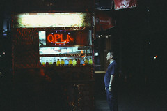 Ektachrome nightcrawlers 9: take a break from graveyard shift (NYC Macroscopist) Tags: man night latenight break streetfood streetvendor urban street manhattan newyork film leica analog vintage 50mm summilux lowlight moody atmospheric