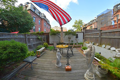 Our garden patio in Boston's South End. (Brooks Payne) Tags: architecture afternoon brooksbos boston brooks garden flag flags historic massachusetts newengland nature summer sky southend nikon d5600 nikond5600