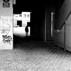 Leaving slowly (pascalcolin1) Tags: paris13 homme man grilles photoderue streetview urbanarte noiretblanc blackandwhite photopascalcolin 50mm canon50mm canon