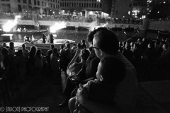 Father and Son ([nixon]) Tags: night fire family father son lights summer fastival nikondf f28 shadow crowd water river boats city downtown bw blackandwhite prime ais