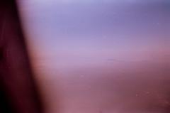 Anticipation (Tamar Burduli) Tags: analog film color 35mm sky skyscape clouds cloudporn travel tamarburduli zenit kodak pink purple violet plane airplane flight fly fog mist nature