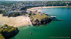 Aerial drone view of beautiful sandy beaches at a colorful, picturesque coastal town (WhitcombeRD) Tags: ancient welsh sunny sand high bay tourist boats destination holiday sea above beach uk coastal architecture aerialview pembrokeshire view visit house town sandy water south tenby landmark side top old vacation drone picturesque tourism resort wales blue coastline beautiful britain travel summer british history aerial seascape tide coast harbour seaside