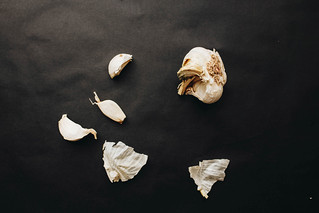 Top view of garlic on dark background