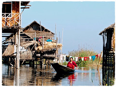 Magical Places and Things - Inle Lake (8) (The Spirit of the World ( On and Off)) Tags: inlelake lake local woman rowing row oar boat rowboat stilts houses laundry reflections everydaylife burma myanmar asia village waterscape