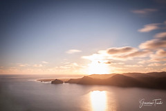 ACROSS THE BAY (Cor Lems) Tags: view clouds ocean landscape sunset orange cloud newzealand heads sky seascape landscapes manukau auckland sea
