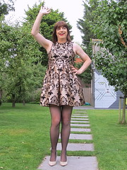 Cheerful salute (Paula Satijn) Tags: girl skirt chic elegant classy happy fun joy outside garden orchard smile lady sweet legs sexy hot heels pumps stockings dress cocktaildress partydress tgirl tranny transvestite trees laugh