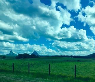 Glasshouse Mountains. Old volcanic plugs seen on the Rockhampton Tilt Train.
