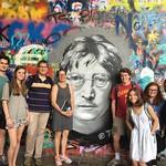 NC State Public History in Prague students and faculty pose at the John Lennon Wall, the site of a clash between authorities and students during the late Communist Era, and now a pilgrimage site for peace activists and backpackers.