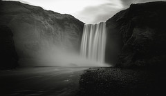 Skógafoss, Iceland (Syed Ali Warda) Tags: artistic amazing arts black white canon art iceland dramatic dark darkclouds drama distinguishedlongexposure excellent exposure exciting explore explored exposed flickr greatphotographers interesting impressive landscape landscapes monochrome outdoor observing outside overcast picture panaromic photo syedaliwarda sea sky mountain ocean water longexposure longexposureshot longexposures waterfalls rock waterfall skogafoss