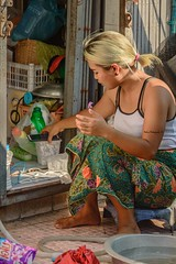 Laundress (Robica Photography) Tags: thailand bangkok street woman lady pretty colourful washing blonde daytime sunny female streetphotography robicaphotography art streetart