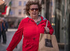 When in doubt wear red. Bill Blass (Lorrainemorris) Tags: zeissbatis85 women candid bokeh glasses dublincity sony zeiss sony7rm2 streetportrait streetphotography red