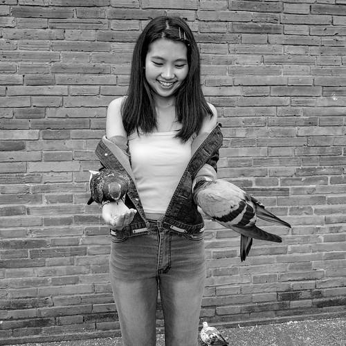 Eileen feeding pigeons, Thae Pae Gate, Chiang Mai