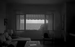 The ocean (Gabo Barreto) Tags: menorca villa window ocean agfaapx100 livingroom holidays sea view grain film 35mm expiredfilm vivitar35es rangefindercamera selfdeveloped scannedfromfilm epsonv500 blackandwhite monochrome