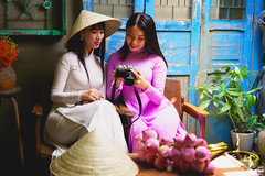 Two beautiful young vietnamese women in Ao dai tradition dresses look a photo on the camera (Patrick Foto ;)) Tags: hochiminh ao asian attractive background beautiful camera cheerful closeup color concept dai detail dress dslr expression face fashion female fun hands hanoi happy hat image lifestyle looking love march people person photo portrait pretty smile style tourism tradition vietnam vietnamese vintage white woman young hochiminhcity hồchíminh vn