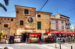 Santanyí 21 June 2018 00016.jpg (JamesPDeans.co.uk) Tags: lamp retail forthemanwhohaseverything landscape shutters street printsforsale shop alfresco table windows jamespdeansphotography eateries cafe mallorca shops commerce objects spain majorca roads chairs wwwjamespdeanscouk umbrella architecture balconies landscapeforwalls europe pavement digitaldownloadsforlicence