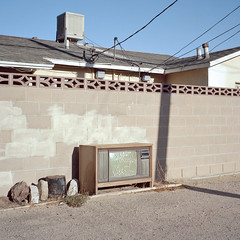 tv party tonight. mojave, ca. 2017. (eyetwist) Tags: eyetwistkevinballuff eyetwist abandoned tv television console tvpartytonight graffiti writing mojave alley mamiya 6mf kodak portra 160 mamiya6mf 75mm kodakportra160 ishootfilm ishootkodak analog analogue film emulsion mamiya6 square 6x6 mediumformat 120 filmexif iconla epsonv750pro lenstagger desert highdesert derelict ca58 kern county lonely american typologies swampcooler cinderblock wall beige junk cathode blackflag brews
