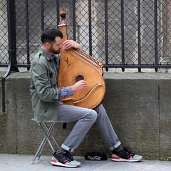 The musician (Ce Rey) Tags: hands manos musica music instrument instrumento street calle paris hombre cuerdas madera wood piedra challenges winner 15challengeswinner