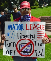 The National March On the NRA in Denver also brought out counter demonstrators like this supporter of President Trump. (desrowVISUALS.com) Tags: demonstration politics rally protest progun 2ndamendment guncontrol politicalprotest americanflagscarf gunprotest nra guncontrollaws pronra nationalrifleassociation