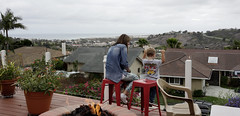DSC01872 (prietke) Tags: unitedstates california ca orangecounty oc sanclemente sc clouds deck flowers ocean pacific pacificocean firepit mother son kid