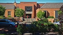 Corvallis-Benton County Library 7 18 2018 (rbdal (Rick Dalrymple)) Tags: serendipity reddress redroses roses library publiclibrary redbrick red corvallisbentoncountylibrary citypark corvallis bentoncounty oregon d7000 nikon