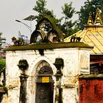 Man sitting outside one of the buildings at the Shree Pashupatinath Temple, Kathmandu, Nepal thumbnail