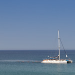 Catamaran lies in a bay in Cyprus thumbnail