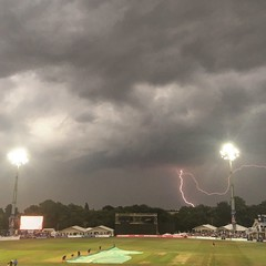 Lightning over Kent cricket club (lucyadunn) Tags: firstlightningpicture firstattempt iphonephotography cricketcovers cricketpitch pitch covers floodlights floodlight event people game cricketgame cricket stormy storm thunderandlightning weather kentspitfires kentcricket frankwoolleystand lightning thunder