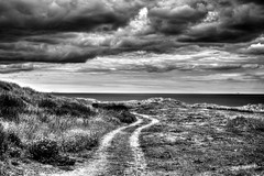 Black and White Beach (Missy Jussy) Tags: blackwhite blackandwhite mono monochrome moody moodylandscape atmosphere sky clouds path grass campingtrip landscape northumberland northeastcoast northsea sea coast 50mm ef50mmf18ll ef50mm canon50mm fantastic50mm 5d canon5dmarkll canon5d canoneos5dmarkii canon