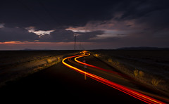 Serpentine (JasonCameron) Tags: road long exposure tail light red night dusk evening sunset clouds storm desert desolate curve