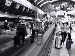 in a rush (giorgioGH) Tags: milanocentralstation milano milan lombardy crowd crowdedplatform strawhat hat reflection riflessi valigia suitcase