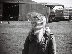 Windy day (Matthew Paul Argall) Tags: jcpenneyelectronicstrobepocketcamera fixedfocus 110 110film subminiaturefilm lomographyfilm blackandwhite blackandwhitefilm 100speedfilm 100isofilm grainyfilm person woman windy windyday badhairday