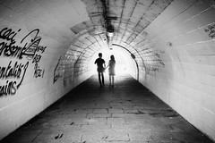 Couple in tunnel (YZ [Street]) Tags: noirblanc streetphoto street bnw streetphotography blackwhite urban noiretblanc sw cities tunnel silhouette bw blackandwhite city downtown