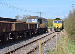 A busy scene at Foxton Exchange Sidings, as Freightliner 66548 runs around the train of spoil it has just propelled in, whilst 56303 waits to propell its train of empties onto the mainline. 18 04 2018 (pnb511) Tags: diesel loco locomotive trains barringtonlightrailway barrington quarry freight traction locos locomotives diesels train track dcr