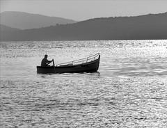 Barcaiolo (ioriogiovanni10) Tags: jovyx74 seguimi photographer fotografo biancoenero monotone ansedonia portoercole nikon sea pescatore barca tramonto mare monocromatico blackandwhite mer toscana