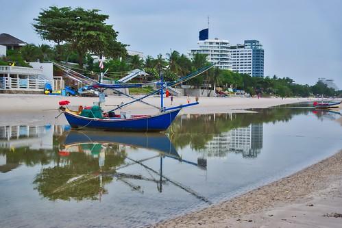 Fishing boat with reflection on Hua Hin beach, Thailand