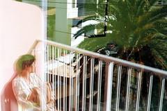 double vitrage, palmier, J (asketoner) Tags: balcony window double girl woman sitting sun spring menorca palmtree hotel