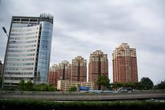 flats (Rasande Tyskar) Tags: china beijing peking 2010 buildings scrapers sky wolkenkratzer street gebäude