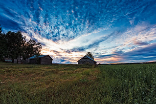 Two Old Barn Houses In The Late Summer Sunset