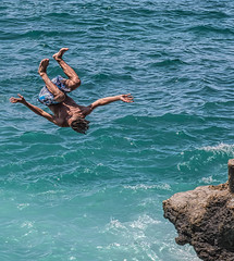 Teens Diving Off Rocks on Beirut's Rocky Shore (stevebfotos) Tags: water lebanon topaz beirut diving teens mediterraneansea rocks beirutgovernorate lb