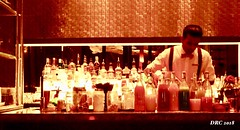 Indian Bartender in the Four Seasons - Doha (DRC - THANKS!! over 2.9 Million Views) Tags: bartender doha qatar bar bottles drinks cocktails