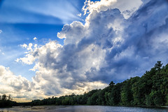 High drama (trochford) Tags: summer storm sky clouds cumulus crepuscular rays crepuscularrays backlit drama water river trees nashuariver minefallspark nashua nashuanh nashuanewhampshire nh newhampshire newengland usa us unitedstates canon canon6d ef24105mmf4lisusm ef24105
