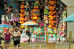 Display at the Fair (qorp38) Tags: yellow colorful display balloons winnie pooh prize umbrella fair