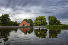 Kameleon (Alfred Grupstra) Tags: reflection nature lake water sky outdoors landscape tree scenics river architecture house summer tranquilscene cloudsky ruralscene pond blue builtstructure nopeople
